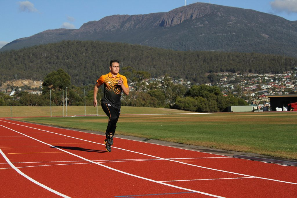 Russel Taib running on track, photo credit: Lilly Castle